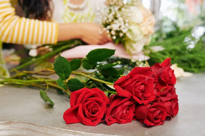 Red roses on counter