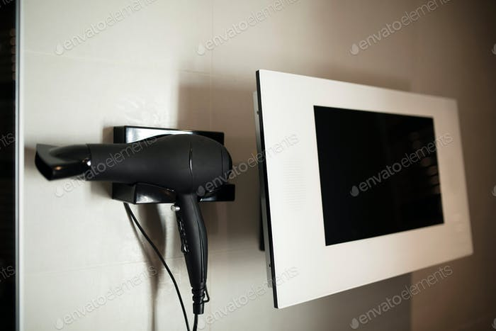 Picture of black hairdryer and white monitor
