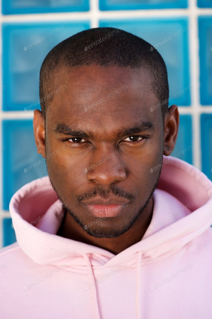 Close up tough african american male fashion model staring