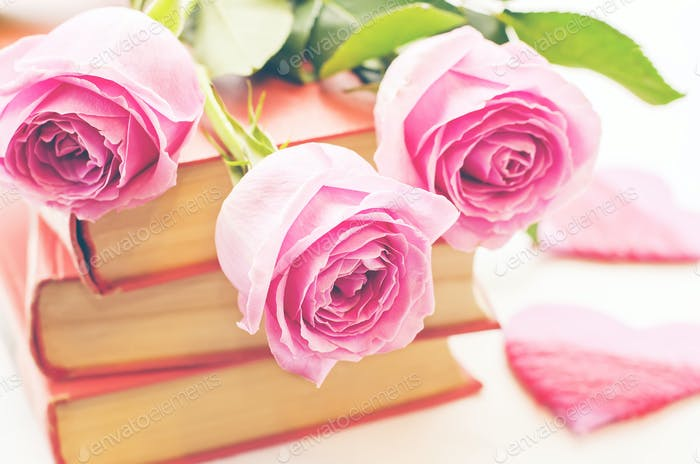 pink roses on a book