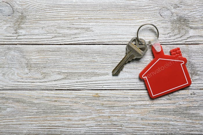 House key with red house shape keychain for real estate concept