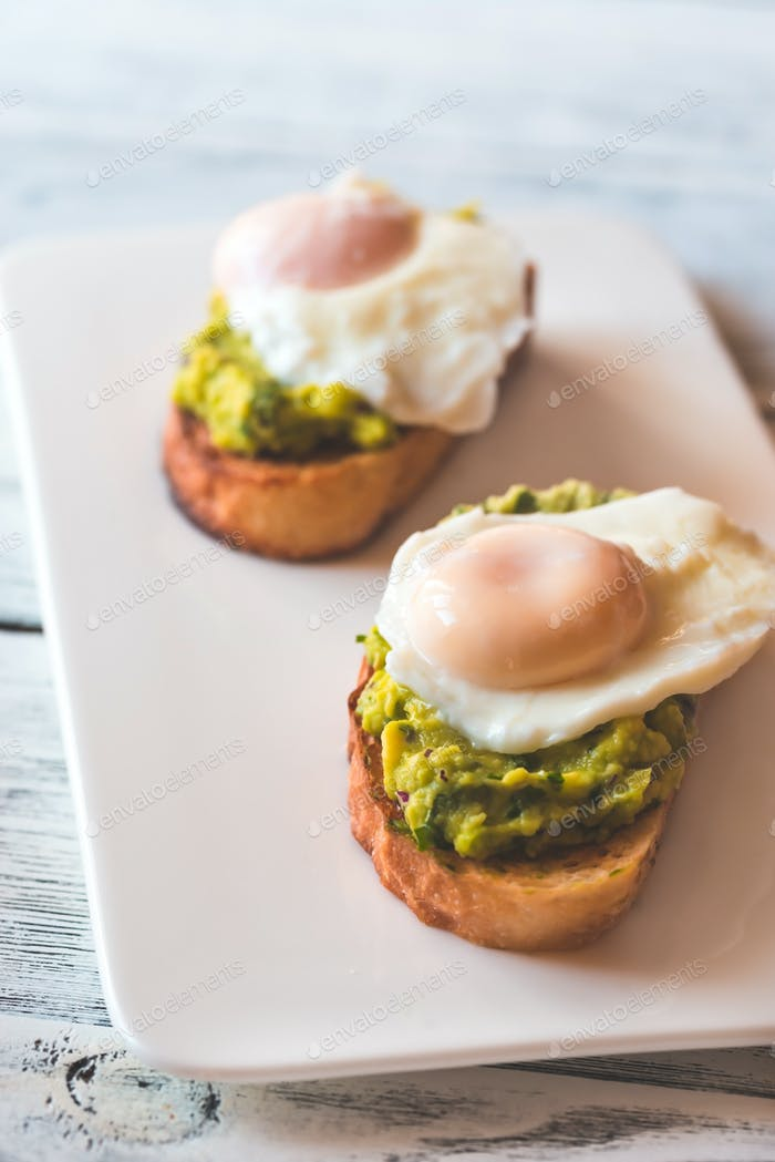 Sandwiches with guacamole and poached eggs
