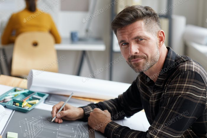 Portrait of Mature Architect at Drawing Desk