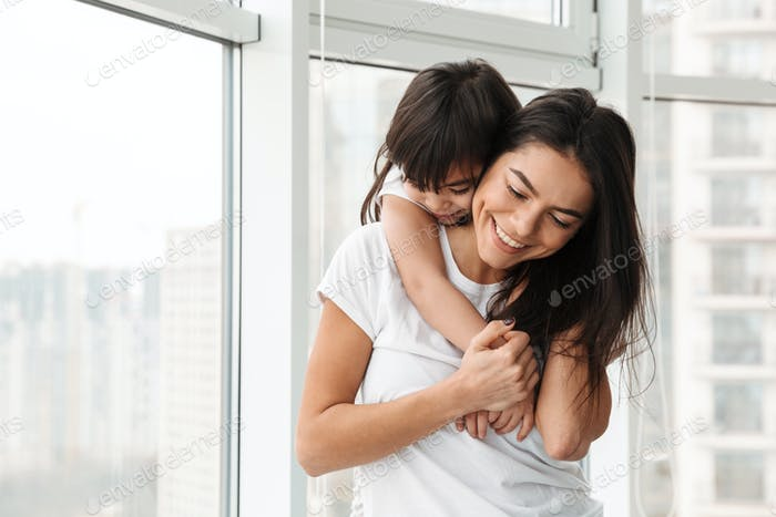 Portrait of amazing family mother and daughter expressing love a