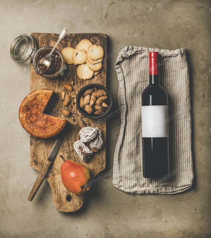 Wine and snack set with over concrete background, top view