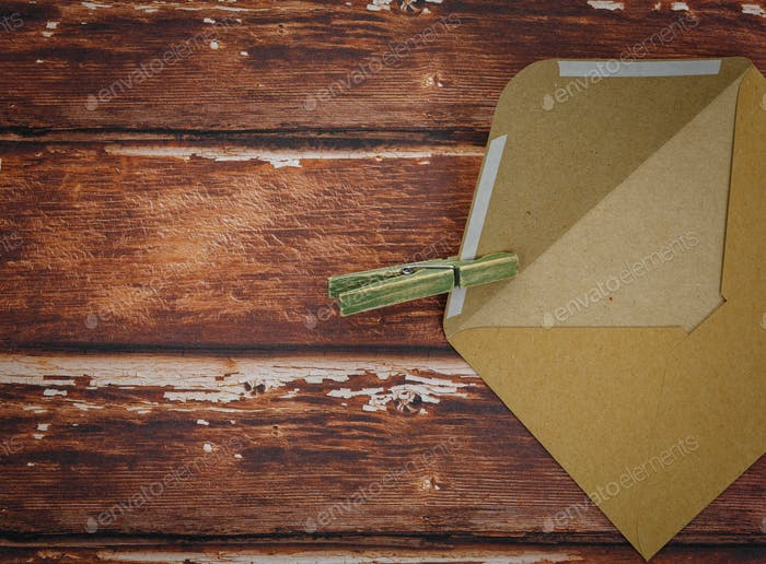 Vintage envelope with pin on wood