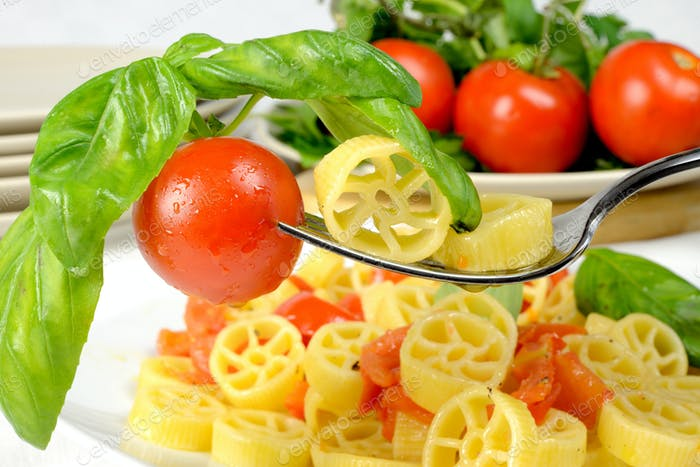 wheels of pasta with fresh tomatoes