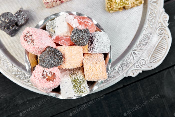 Set of various Turkish delight in bowl on metal tray