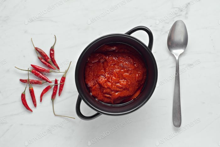tomato sauce and chiles on marble