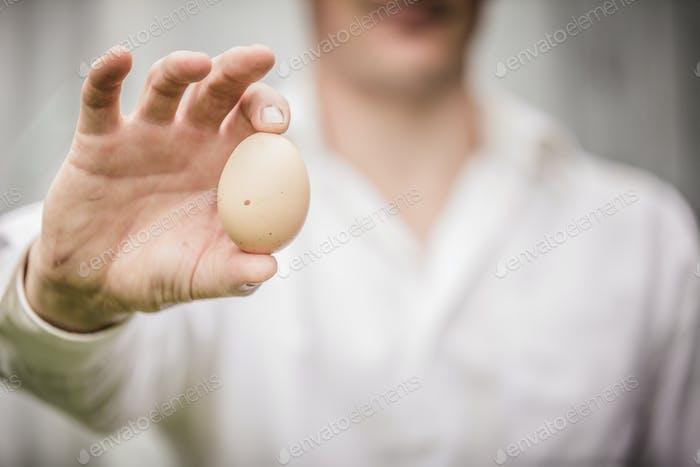 Farmer Showing an Egg