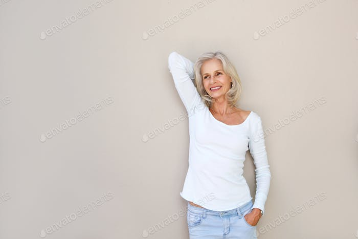 carefree happy older woman with hand to head