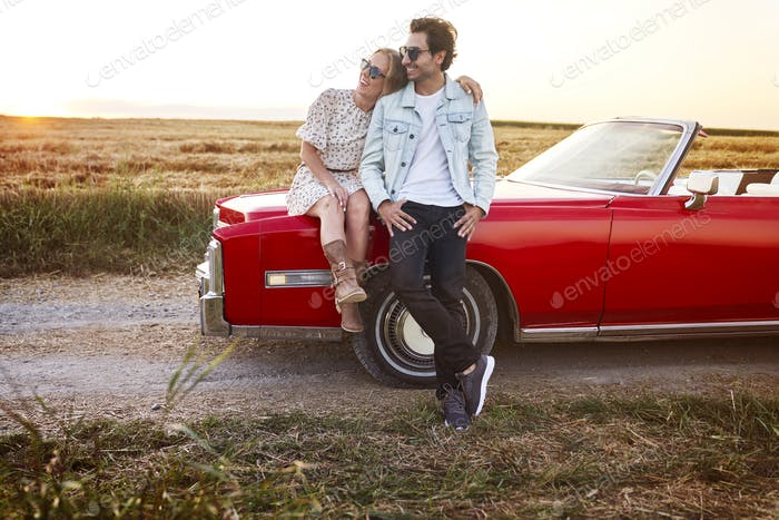 Couple on a date by the car