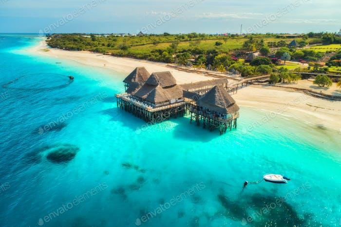 Aerial view of beautiful hotel in Indian ocean at sunset