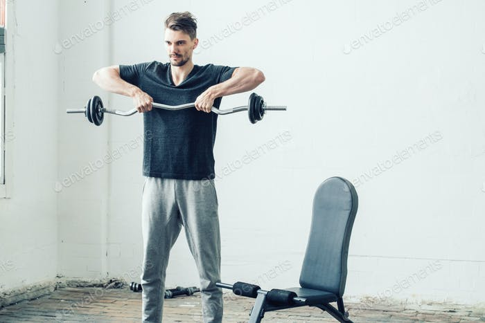 Man in gym. Sport handsome guy on sporty training