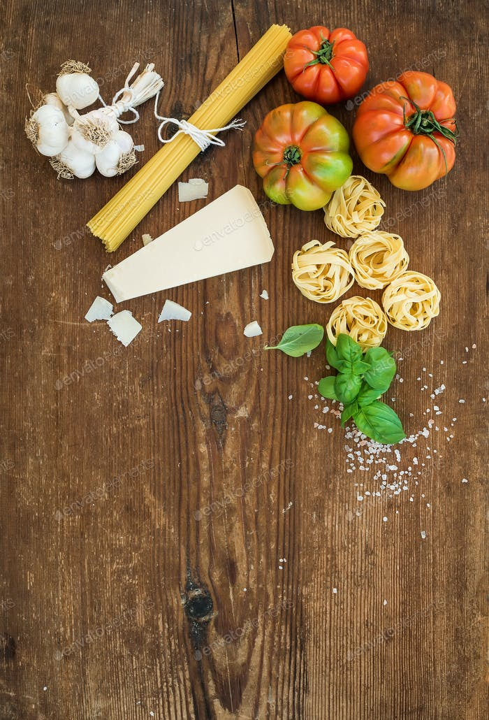 Ingredients for cooking pasta. Spaghetti, tagliatelle, garlic, Parmesan cheese