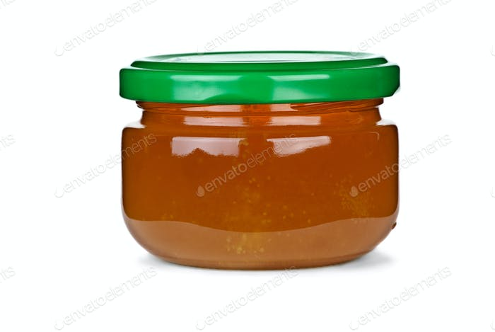 Tiny glass jar with honey