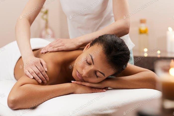 Blissful Woman Enjoying Massage