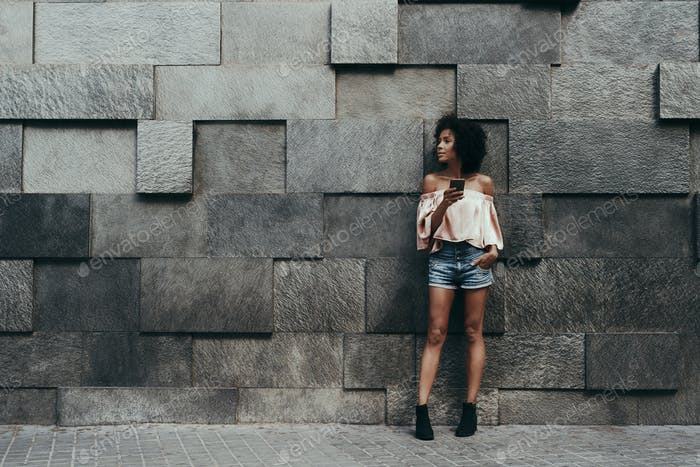 Brazilian girl and displacement wall