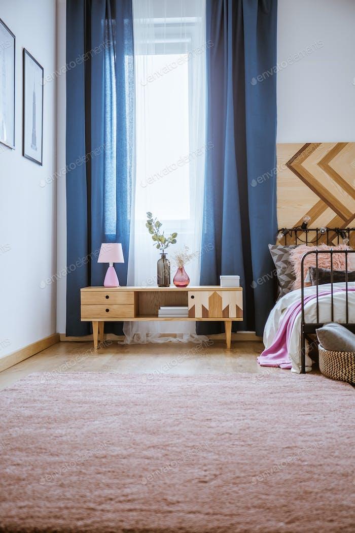Pastel bedroom interior with cupboard