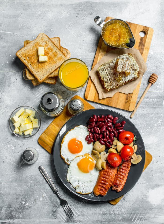 English breakfast. A variety of snacks with orange juice.