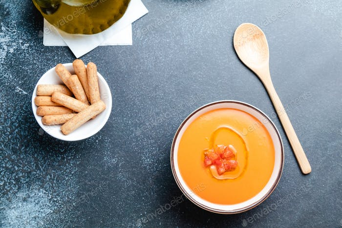 bowl with salmorejo, a typical spanish tomato soup similar to the gazpacho