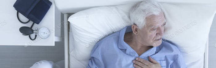 Elderly man suffering from chest pain
