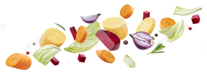 Falling pieces of different vegetables isolated on white background