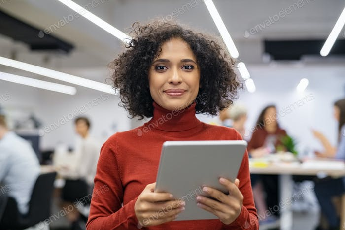 Mixed race young woman using digital tablet
