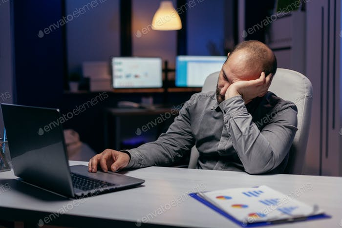 Hardworking manager napping at workplace