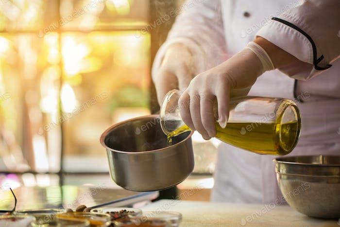Liquid pours into a saucepan