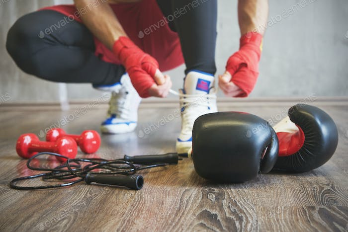 Boxer man preparing for training. Sport accessories.