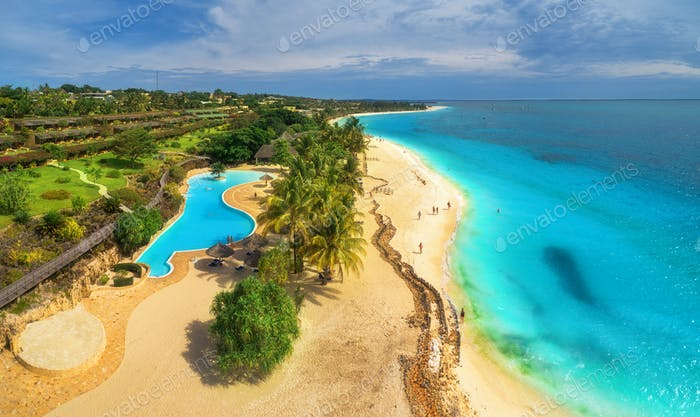 Aerial view of sea coast. Sandy beach with pool