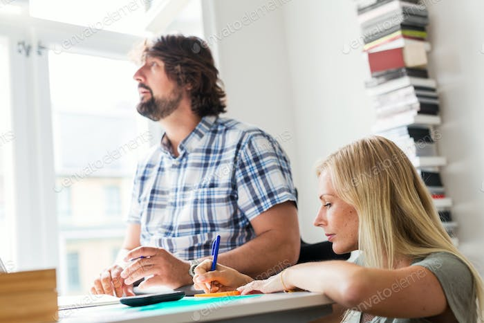 Editors working together in office