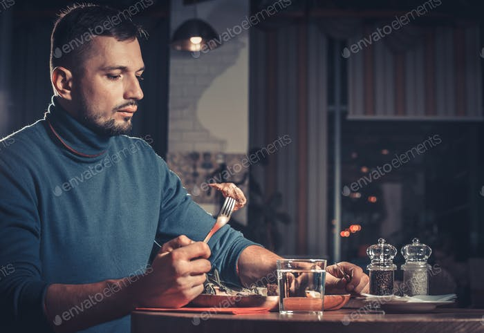 Handsome man at restaurant