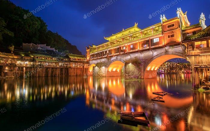Hong bridge (Rainbow bridge) at night in Fenghuang old city ,Hunan Province, China