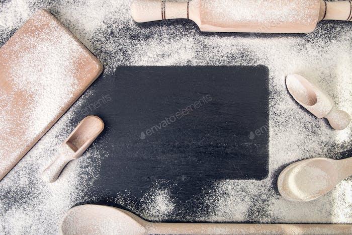 Book for recipe around utensils and flour