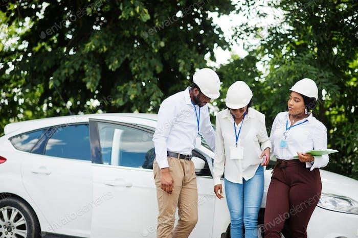 Group of three black engineers meeting.