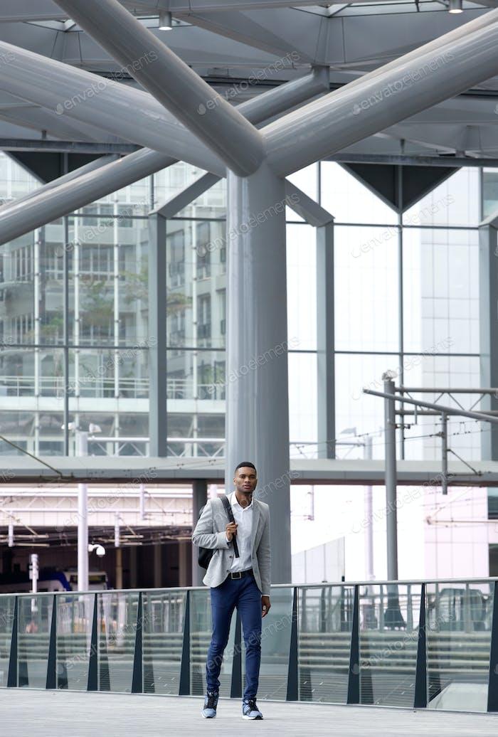 African man walking alone at airport