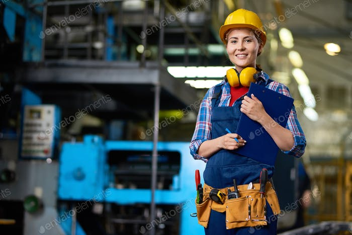Smiling Female Worker at Factory