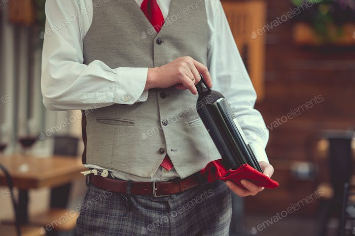 Waiter with a bottle