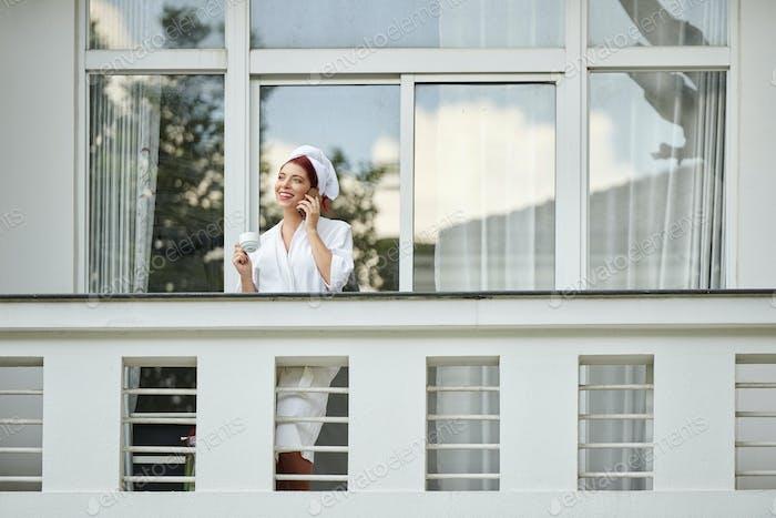 Pretty woman on hotel balcony