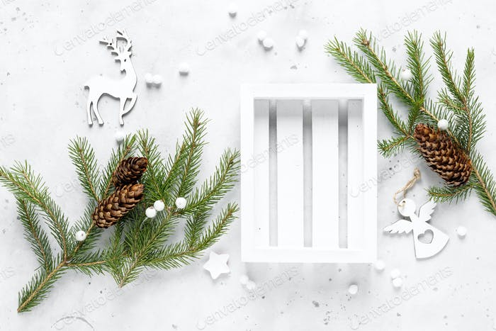 Christmas, Noel or New Year flat lay background with white crate box, fir tree and xmas decorations