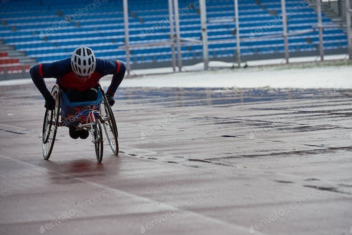 Determined paraplegic sportsman racing in handcycle at outdoor stadium