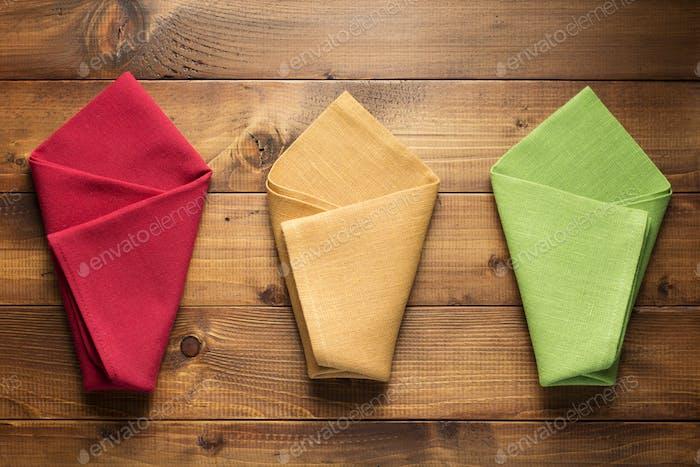 folded napkin on wooden background