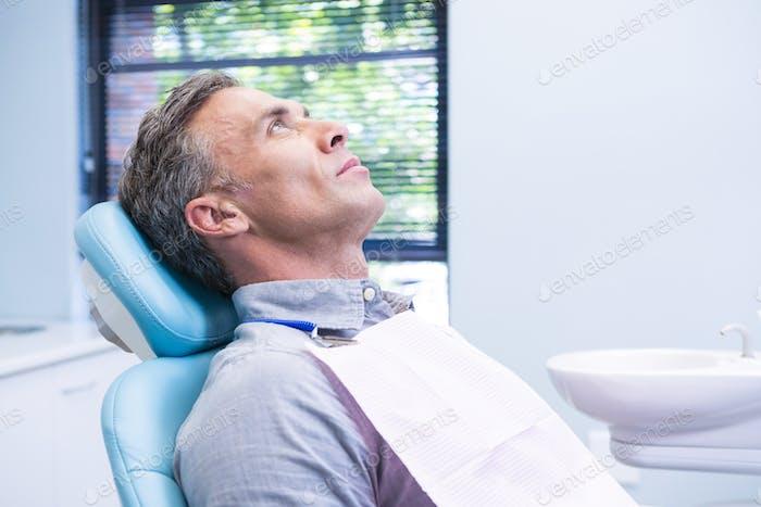Patient sitting on dentist chair