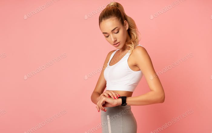 Girl Using Smartwatch Or Fitness Tracker During Workout, Studio Shot