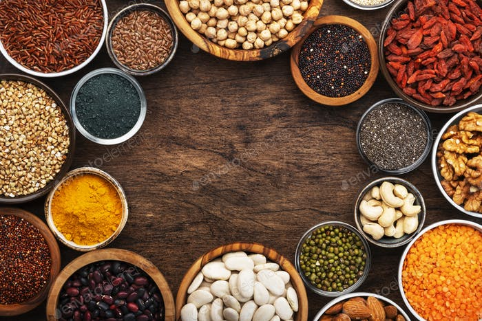 Superfoods, legumes, nuts, seeds and cereals set in bowls