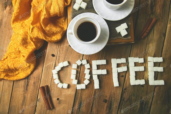 Symbolic image. Text of cube sugar. Sign coffee.