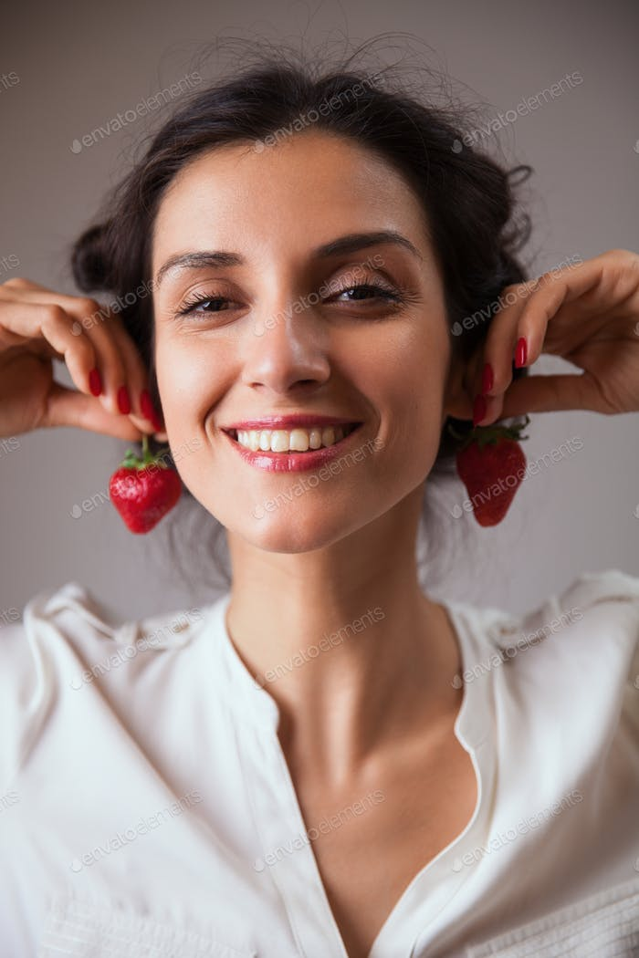 Young woman with cherry tomatoes