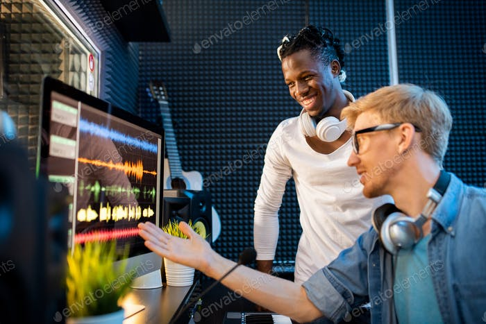 Young musician or producer showing African man group of sound waveforms
